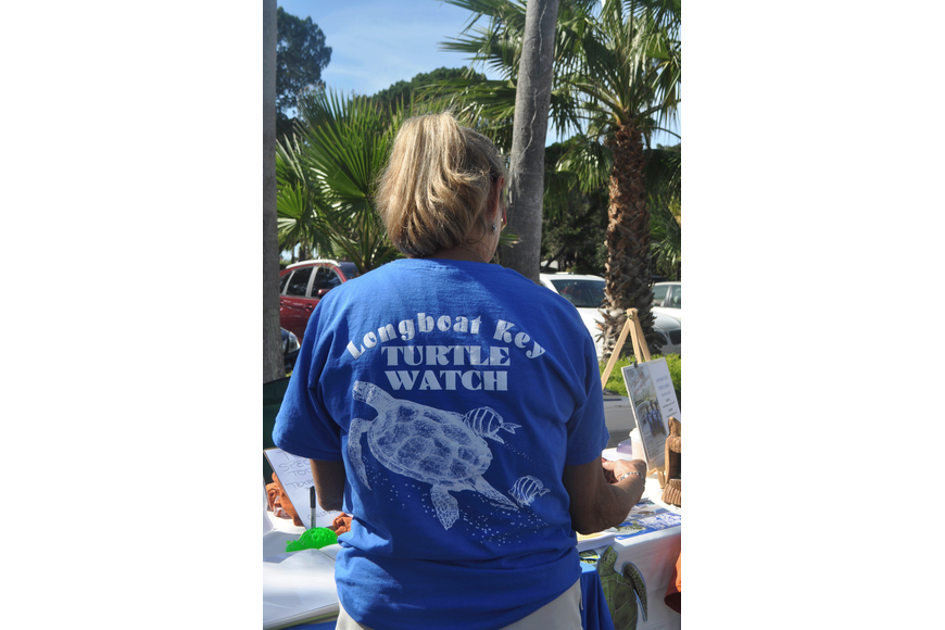 Melissa Herron models Longboat Key Turtle Watch's new t-shirts.