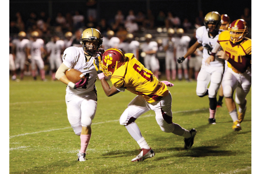 Cardinal Mooney's Sean Morris, No. 6, tries to stop St. Petersburg
