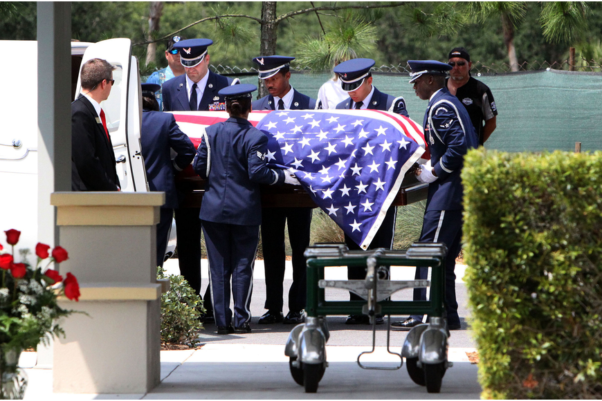 Pallbearers lifted Longboat Key Police Chief Albert Hole's casket at May 24 at the Sarasota National Cemetery.