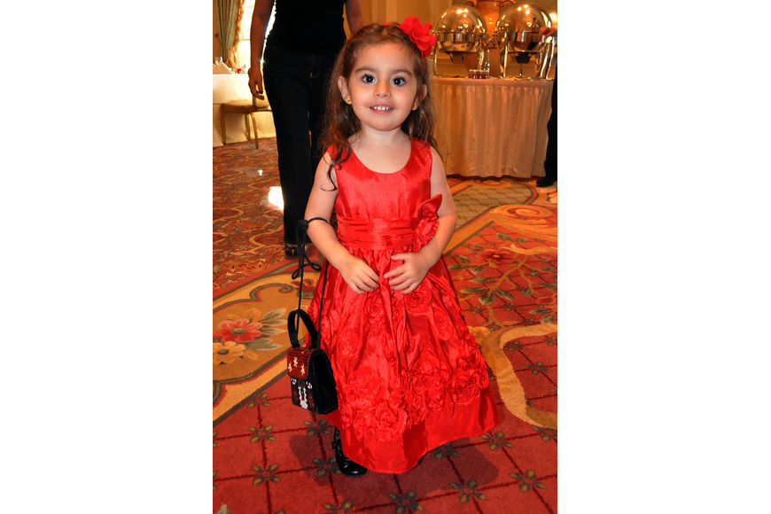 Valentina Cola, 3, wore a fancy, red dress, matching headband and carried a holiday purse at the Breakfast with Santa at the Ritz Carlton.