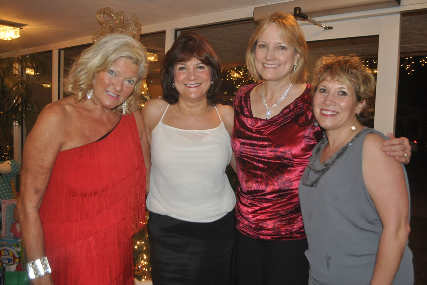 Heidi Lagro (far left) hosted 100 guests, including Judy Johnson, Diane Doolittle and Lisa Margolies, at her Arbomar home Dec. 6 for Christkindl, a German-themed Christmas party to benefit Toys for Tots.