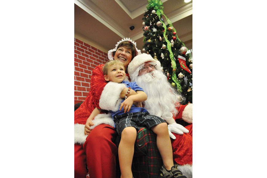 Zachary Roy, 2, smiles during his visit with Mrs. and Mr. Claus, portrayed by Jeanne and John Larranaga, at Heritage Harbour's Breakfast with Santa Dec. 1. Published Dec. 6, 2012.