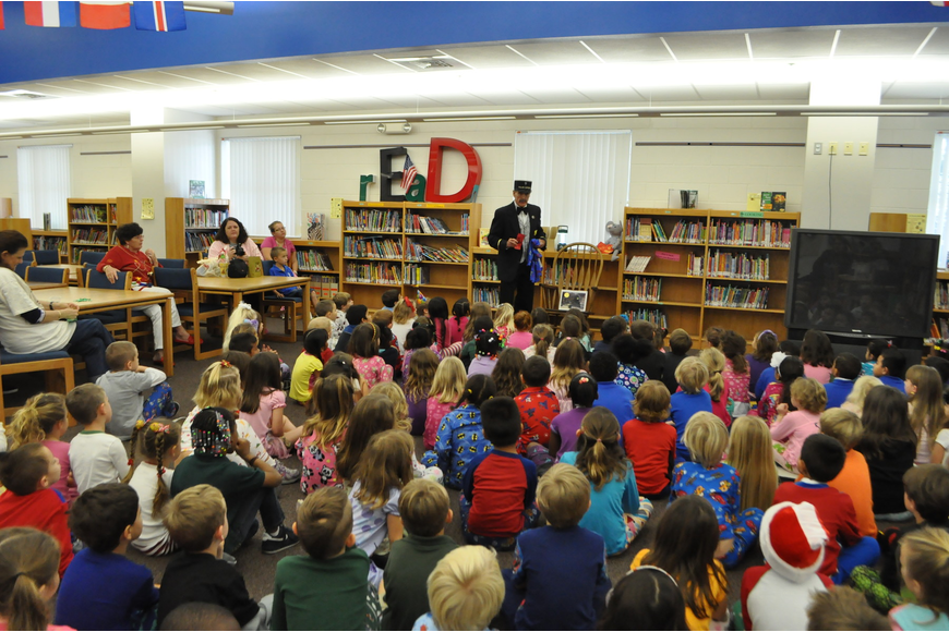 Seven kindergarten classes listened to Patrick Sanders tell the story of the Polar Express.
