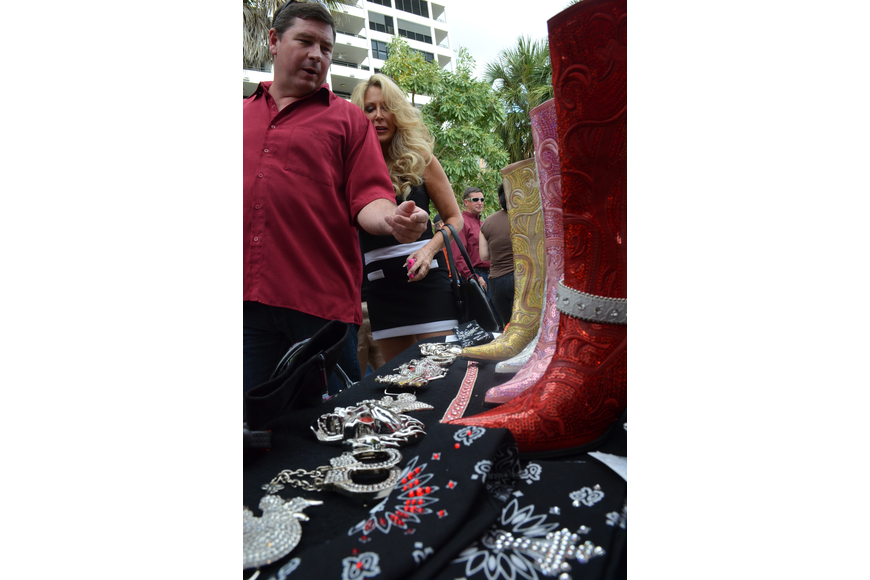 Scott Swisher checks out some sparkly boots.
