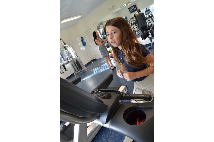 Lexie Kozel tries out the treadmill at the new Wellness Center.