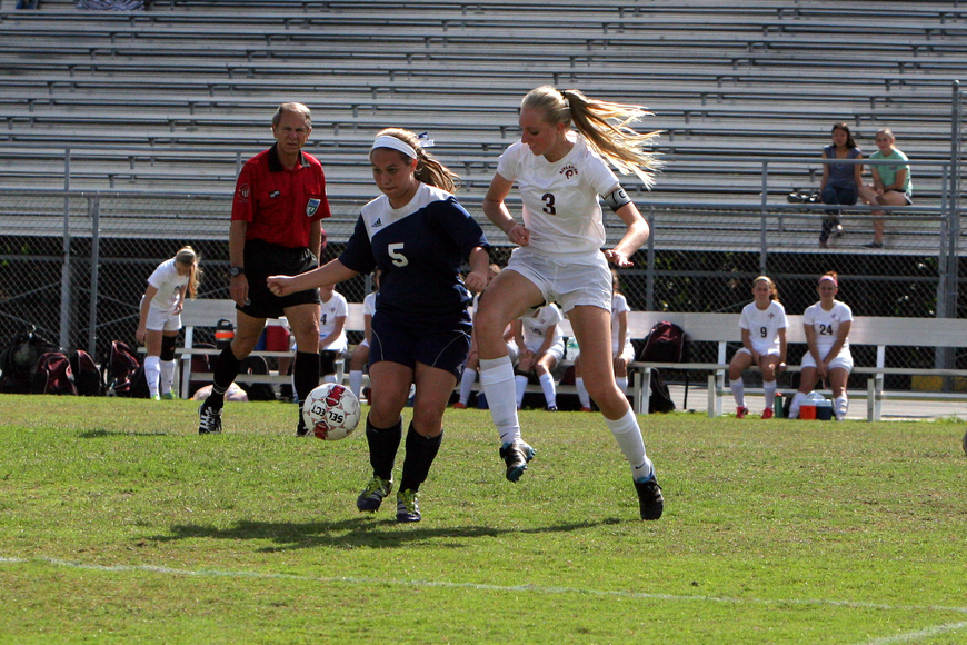 North Port's Jenna Staub, No. 5, and Riverview's Gabrielle Falco, No. 3, both go for the ball.