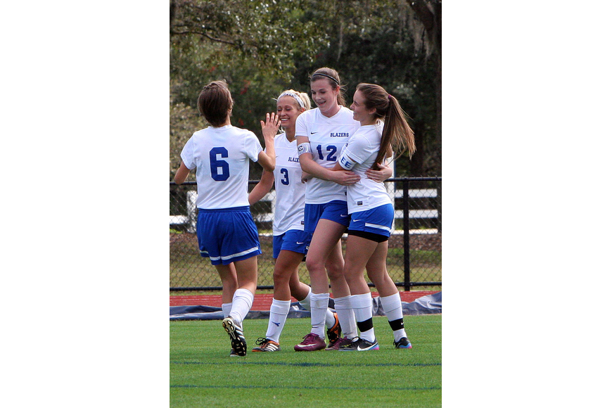 Sarasota Christian celebrates Kelsey Murphy's, No. 12, goal during their game against Northside Christian Tuesday, Jan. 15, at Out-of-Door Academy.