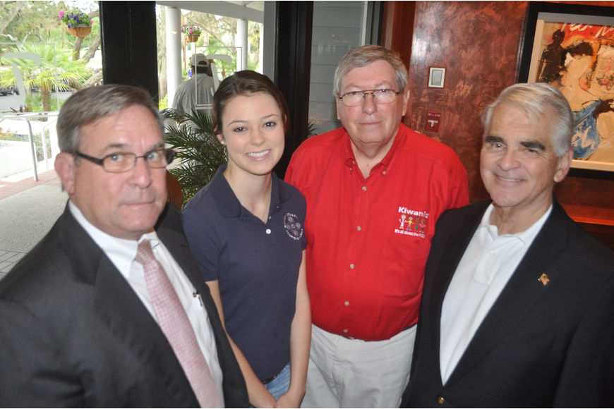 Richard Crawford, Abigail Oakes, president of Circle Key International Club of New College, John Wild, Jim Burmeister