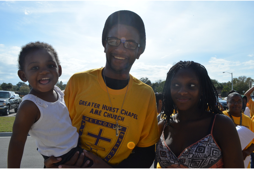 Demetrius Rock with his second cousin Ja'Laziah Hill and her mother Jerrica Hill.