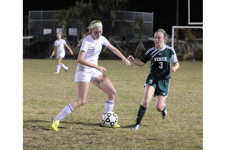 Lakewood Ranch midfielder Talia Falco battles a Venice opponent for possession in the second half.