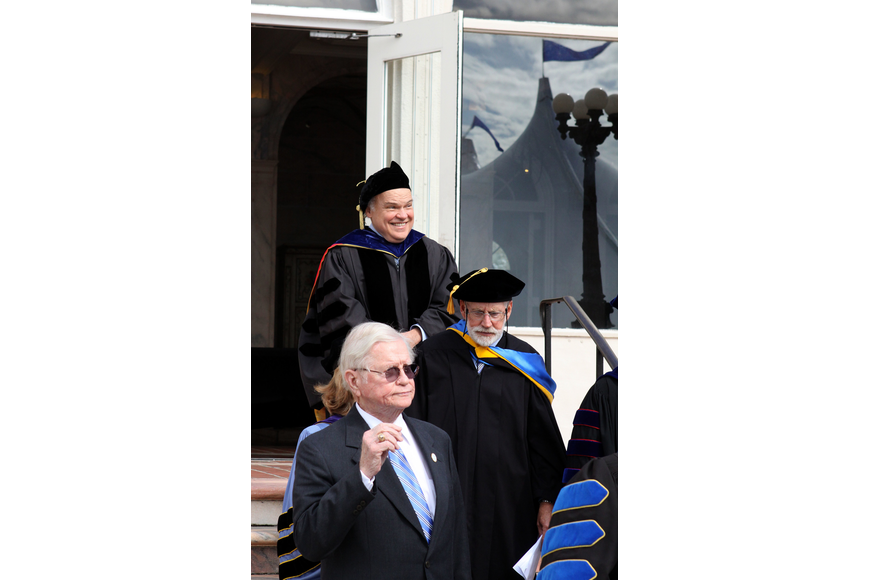 Dr. Donal O'Shea walks out of College Hall and heads towards the tent to be inaugurated as New College's 5th president.