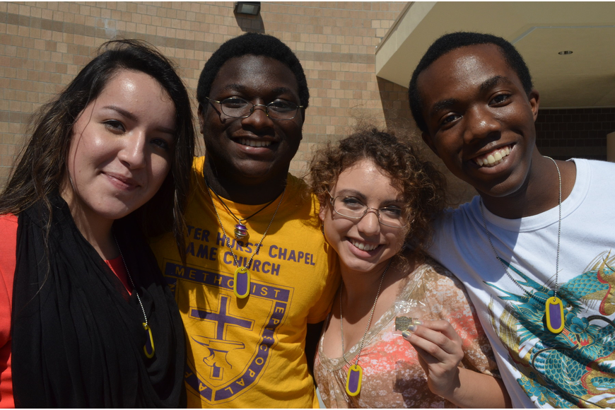 Seniors Amy Galloza, Dylan Rock, Erica Janko, and Treyvon Thomas all wear gold dog tags signifying a 4.0 GPA or higher.