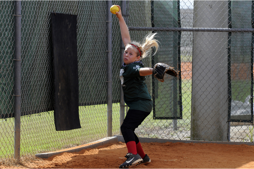 Nine-year-old Faith Ross got the call on the mound for Planet Stone.