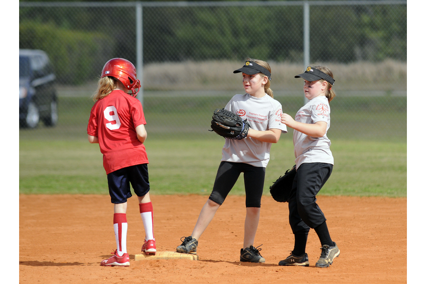 Reagan Wilson, 9, beats the tag from Pemco's Kimberly Koelsch, 8, and Mya Blue, 7.