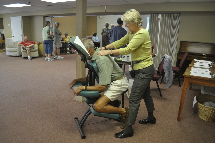 Liz Yerkes gives Marv Herpel a back massage.