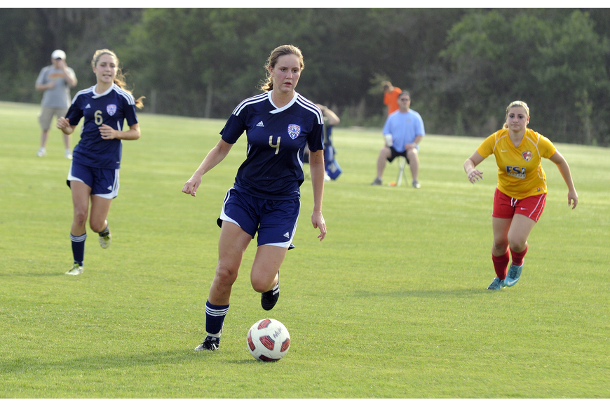 Mackenzie Weeks brings the ball down the field for the West Side Lady Eagles.