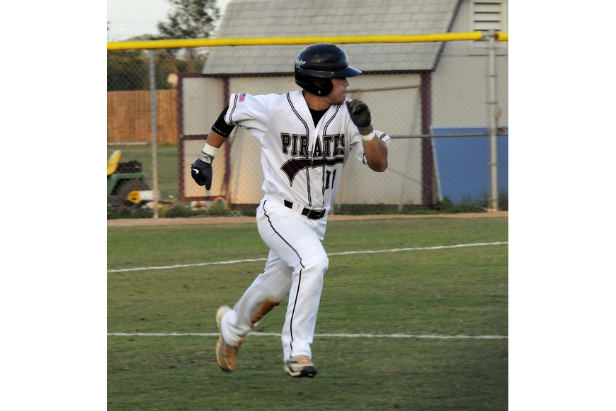 Justin Phillips races down the first base line in the bottom of the third inning.