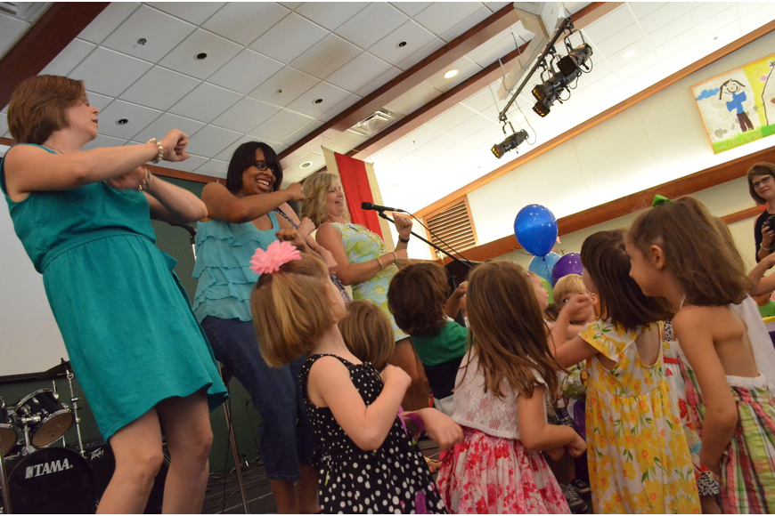 Staff dances with children at the Butterfly Ball.