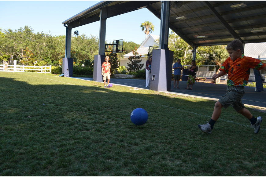 Giovani G. Gets ready to kick the ball in a game of kickball.