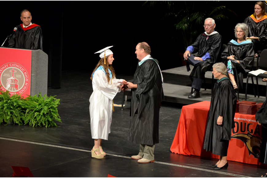 Students receive their diplomas.
