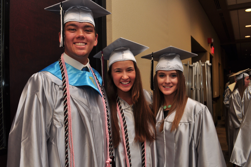 Commencement speakers Nathan Evens and Emily Mingote with Senior Class President Shelby Graves