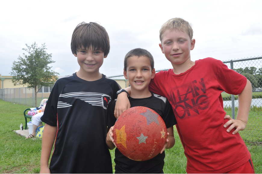 Noah Ellis, Aiden Brown and Isaac Ashley took a break from kick-ball.