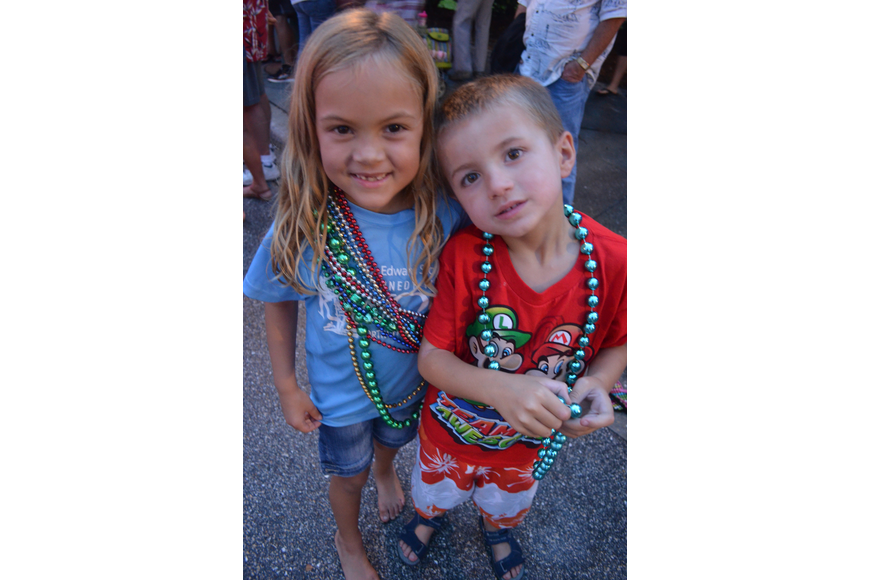 Kara Crawford, 7, and her brother Kameron, 6, dance at the block party after the parade.