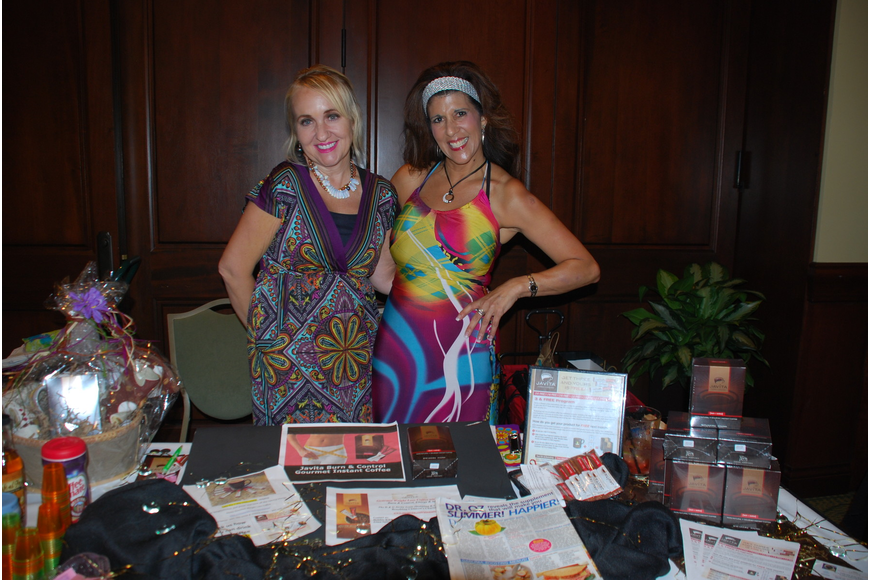 Penelope Hagrett Mabrey and Gina Spicer of Manatee Children's Services took part in fundraising