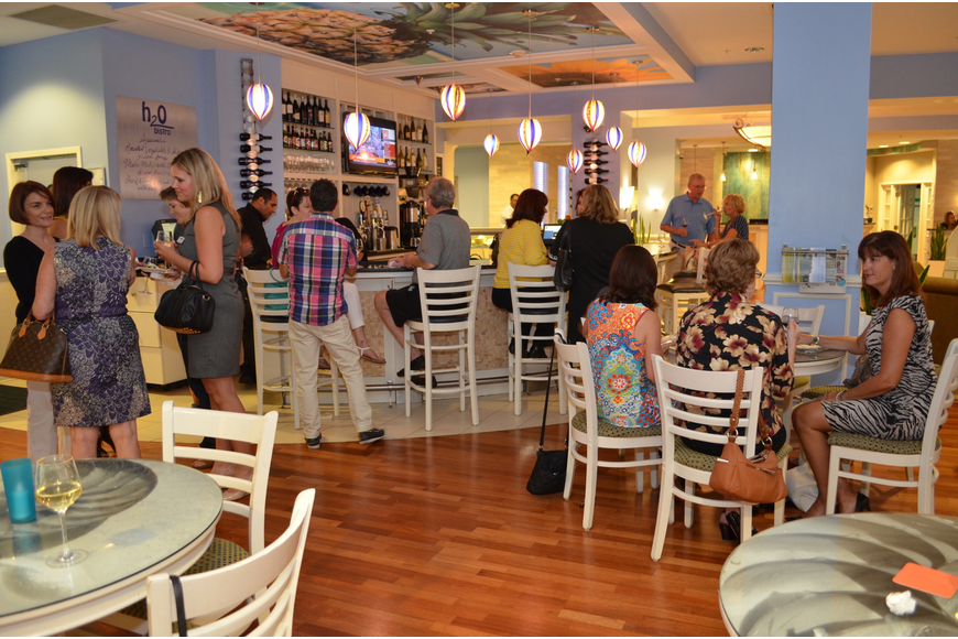 St. Armands Association members mingle at the membership meeting Tuesday, Sept. 17, at Hotel Indigo.