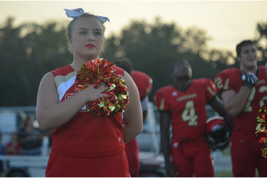 Elizabeth Reynolds, 16, watches the American flag during the National Anthem.