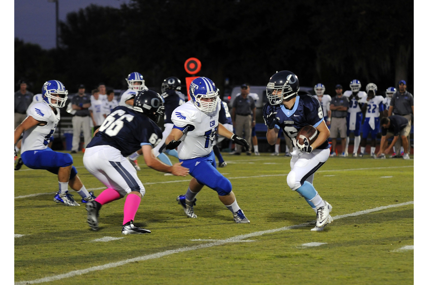 Running back Jason Fineberg carries the ball for a 5-yard gain.