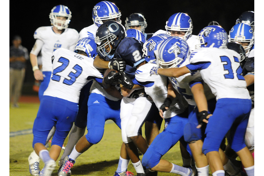 ODA freshman running back Amad Brayboy pushes his way through a host of Community School of Naples defenders.