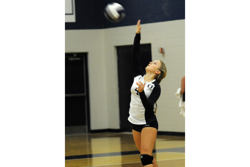 Freshman Greta Holland serves the ball to open the match for ODA.