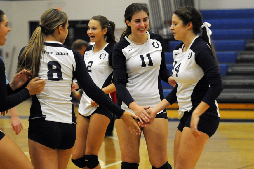 The ODA volleyball team celebrates a point during its 3-1 victory over Calvary Christian in the Class 3A-Region 3 quarterfinals Oct. 29.