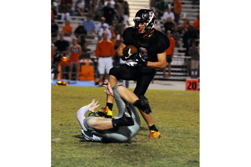 Sarasota wide receiver Dylan Cleveland shakes a Lakewood Ranch defender for a 30-yard gain.