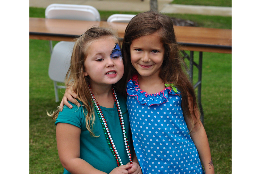 Isabella Violetto, 4, and Emma Rodman, 6, enjoy the day's festivities.