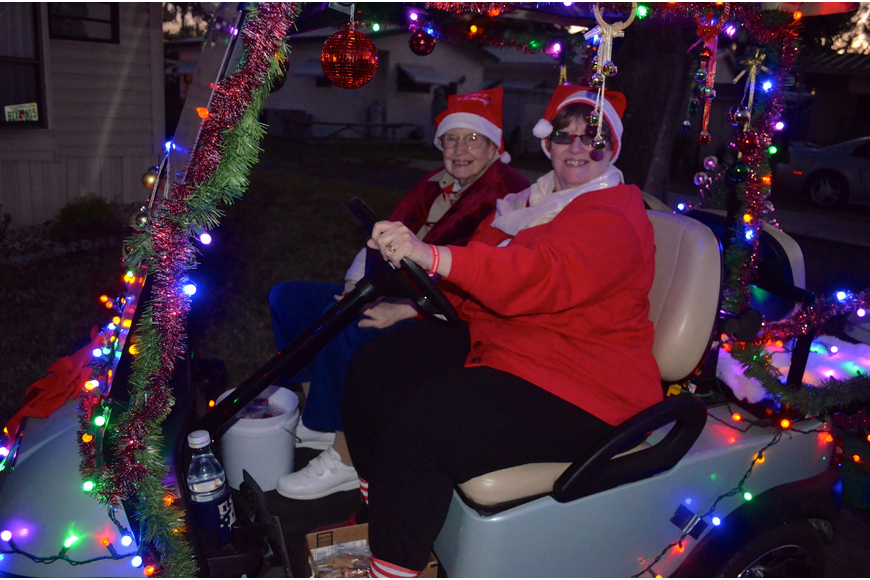 Donna Amsden and her niece Maxine Teachout enjoy the view of the other brightly-lit carts.