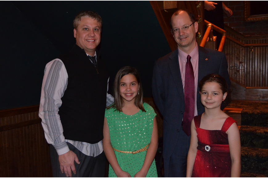 Natalie and Scott Rogers with Kiwanis Club President John Moore and daughter Katherine.