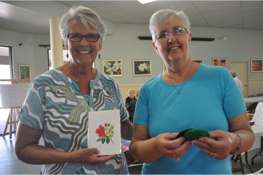 Julie Sanders, who purchased letters, with Gean Miller, a crochet artist.