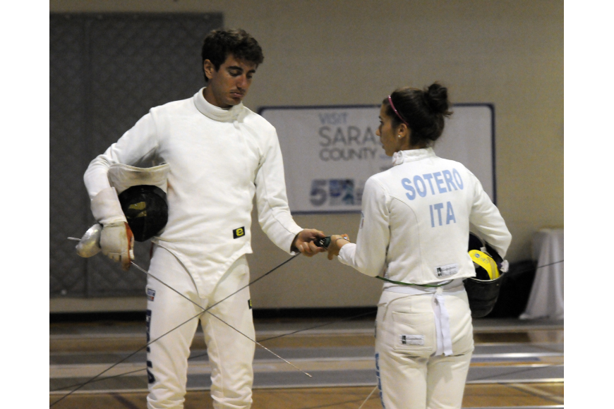 Italy's Riccardo De Luca and Alice Sotero strategize before the start of their next bout.