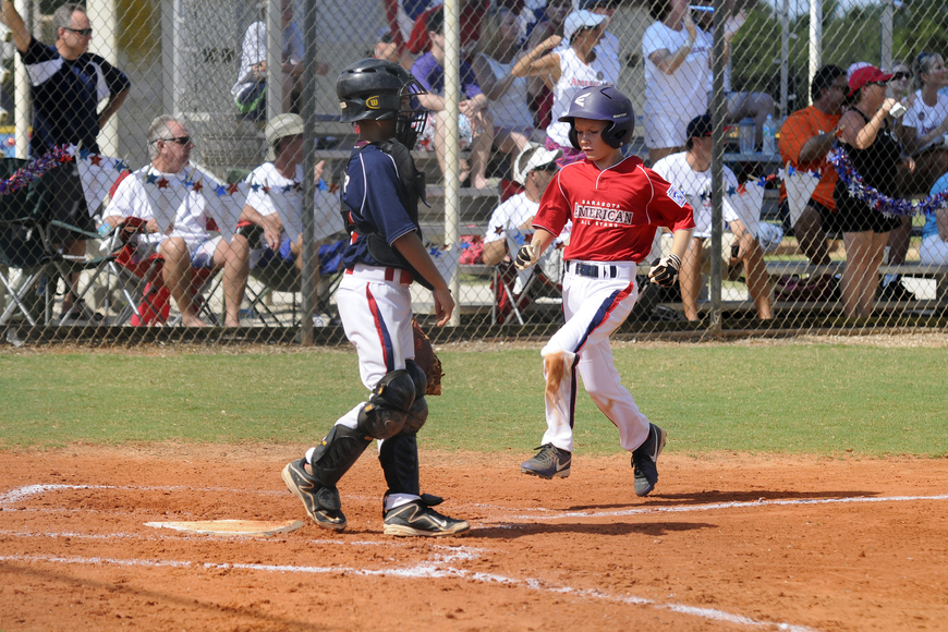 Austin Harford scored a run for the Sarasota American 9/10 All-Stars in their tournament opener versus Sarasota National.