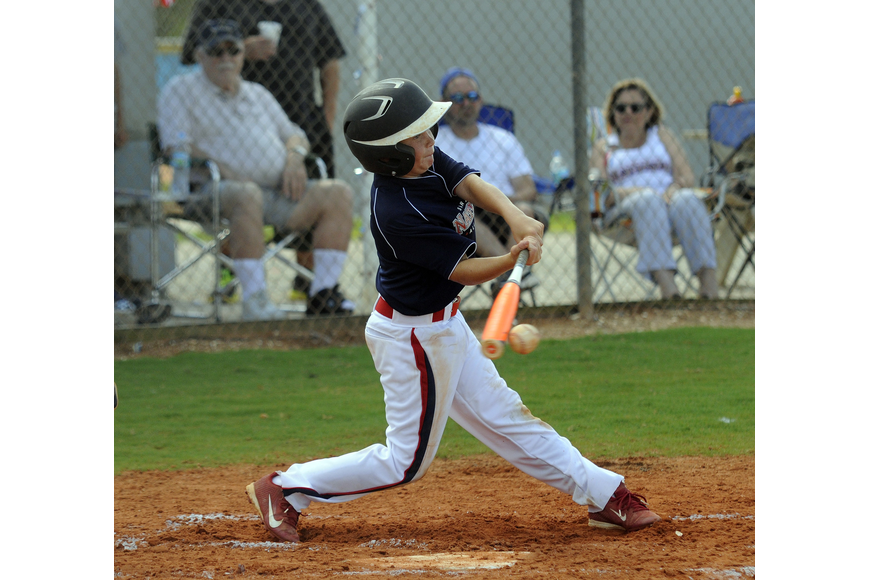 Hunter Henson makes contact during the Sarasota National 10/11 All-Star team's game versus Sarasota American.