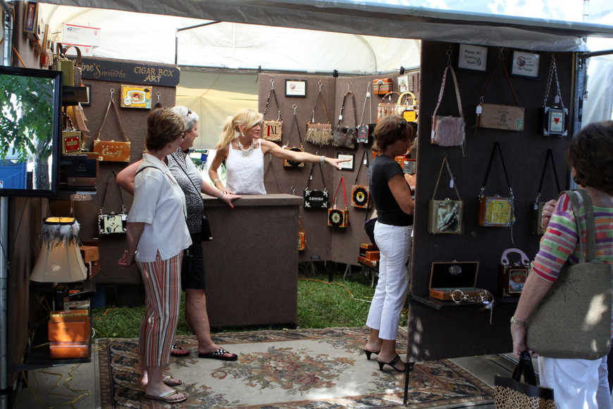People look inside the tent for Elaine's Sarasota Cigar Box Art at the St. Armands Art Festival.