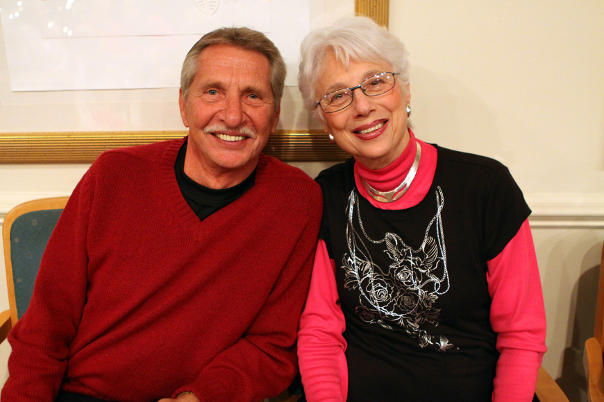 Don Cooks and Jo Zentz sit near one another at the holiday party at Seaplace.