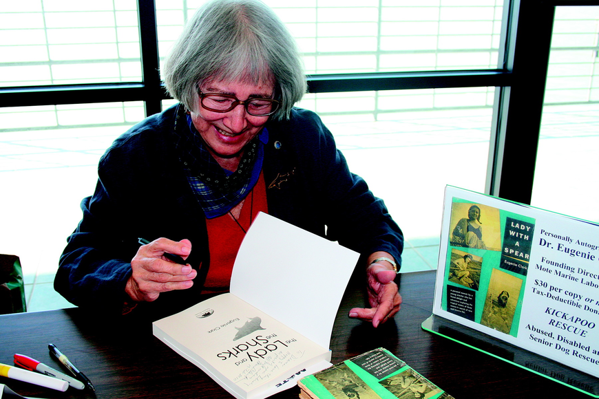 Dr. Eugenie Clark autographed a copy of the new edition of her book,