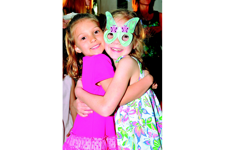 Ella Menke and Ella Wicks hug in March at First Presbyterian's Butterfly Ball.