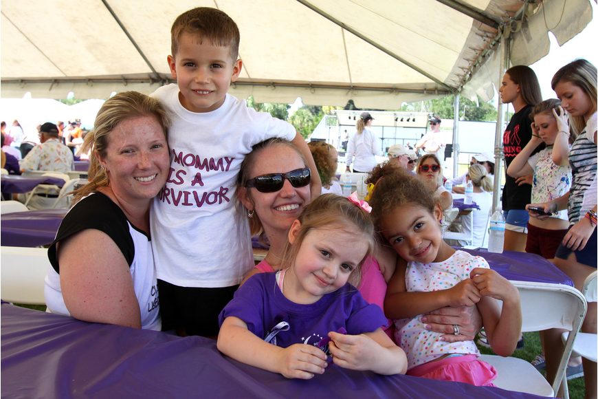 Survivor Amanda Worth poses with her son, Anthony, and her friends Samantha and Chloe Cook and Sydney Fieber during Relay For Life on Saturday, April 9 at Sarasota High School.