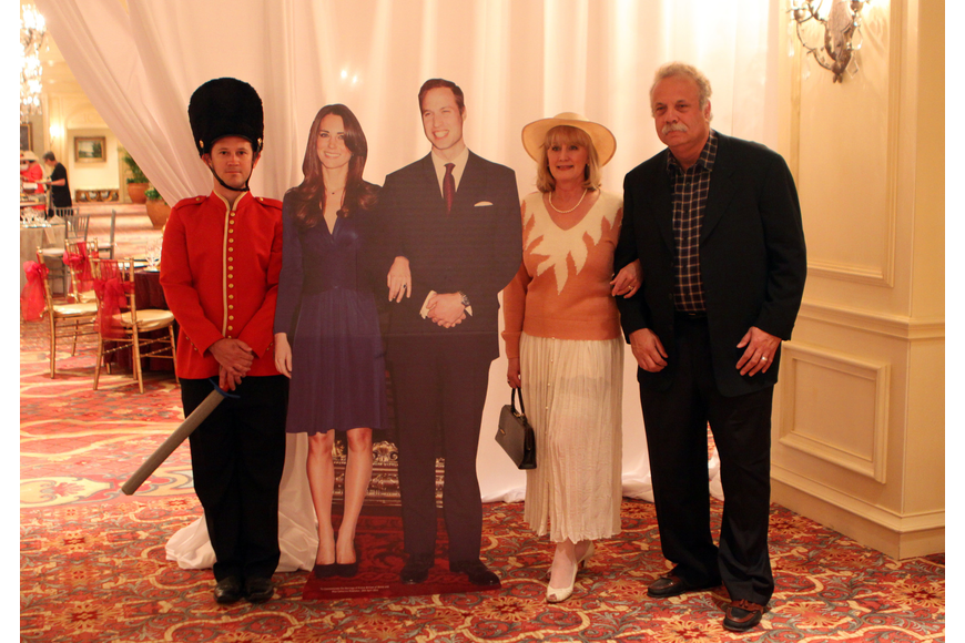Michelle and Robert Slider pose with the royal wedding couple and guard, Chris Starman on Friday, April 29 at the Ritz Carlton.