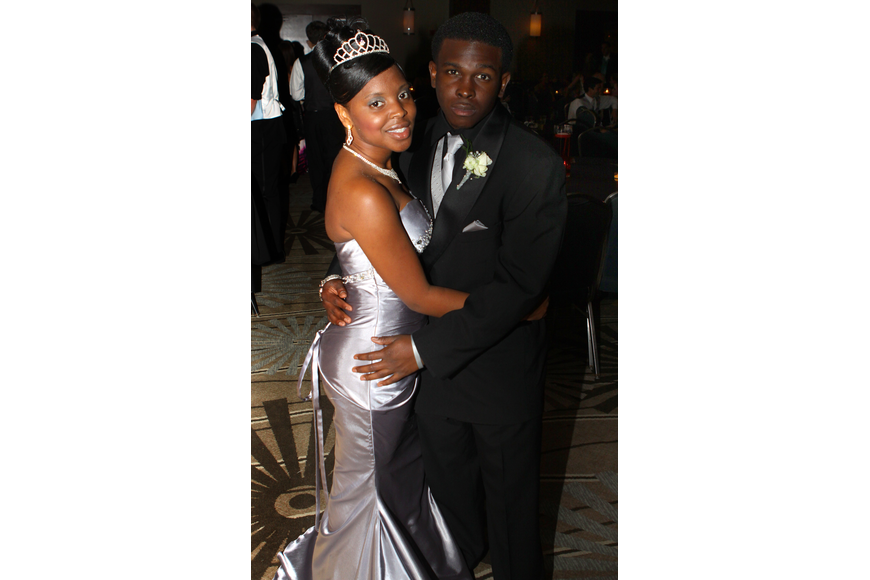 Shauntavia Green and Liejerren Swilley pose together Saturday, May 14 at the Sarasota High School's prom at the Hyatt Regency.