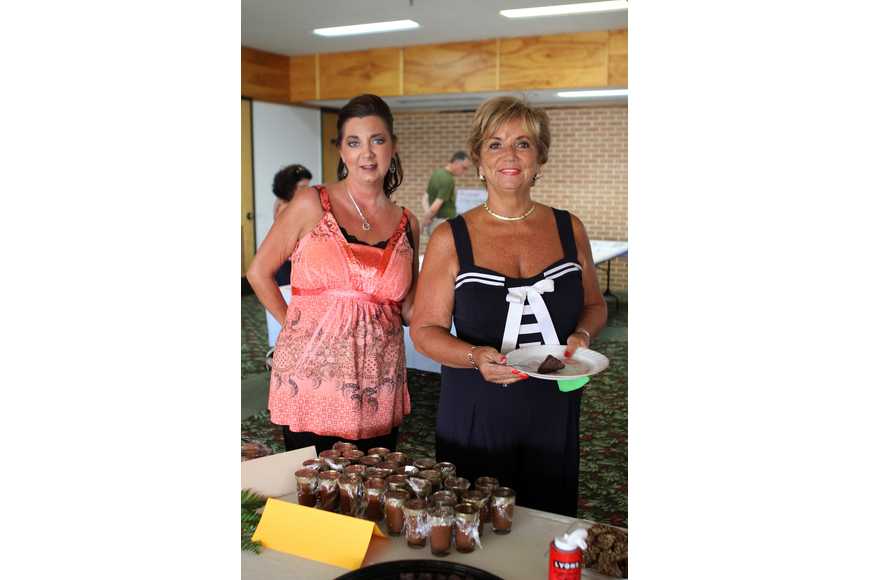 Debra Nespor and Cheryl Nespor get ready to try some of the desserts donated by 29 different donors for Family Promises' Third Annual Just Desserts event Friday, May 20 at Selby Garden's Great Room by the Bay.